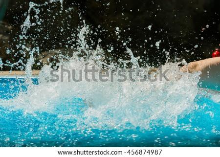 Pool Water Splash swimming splash stock photos, royalty-free images & vectors