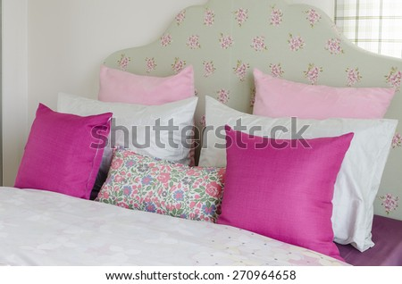 girl's bedroom with pink pillow on green bed at home - stock photo