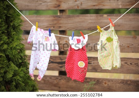 girl's clothes hanging on rope - stock photo