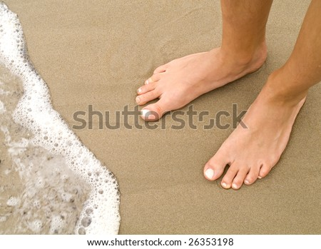 girl's feet on the beach