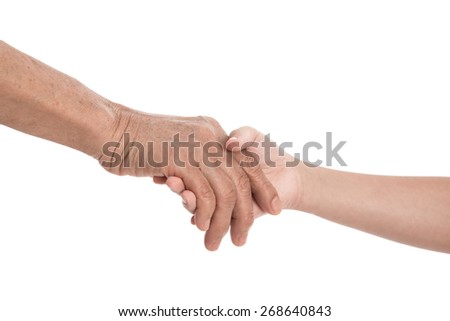 Girl's hand holding old woman's hand on white background isolated