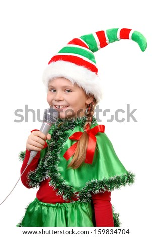 Girl - Santa's elf with a microphone isolated on a white - stock photo
