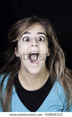 Girl screaming in uncontrolled urban street, madness