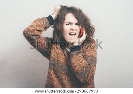 girl screaming on a cell phone - stock photo