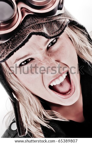Girl Screaming with Steam Punk Goggles and aviation hat on - stock photo