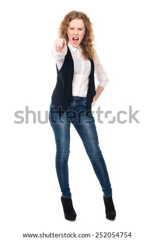 Girl screams and points his finger at the camera. Isolated on a white background - stock photo