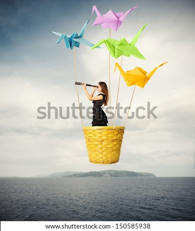 Girl searching for new fashions with origami - stock photo
