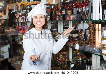 Girl selling fine chocolates and sweet pastry