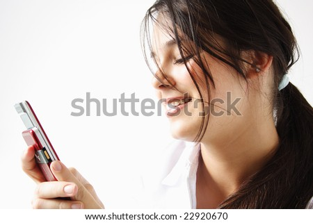 Girl sending an sms dressed in white isolated.