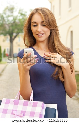 Girl sends a message after purchase - stock photo