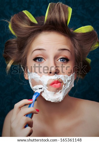 Girl shaving face  - stock photo