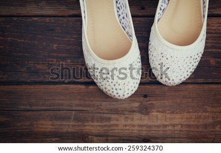 girl shoes over wooden deck floor. filtered image.  - stock photo