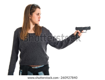 Girl shooting with a pistol  - stock photo