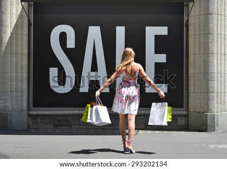 Girl shopping at the sale - stock photo