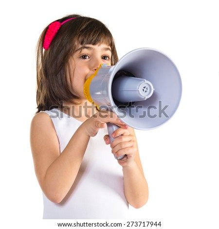 Girl shouting by megaphone   - stock photo