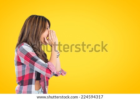 Girl shouting over isolated yellow background