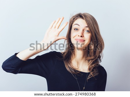 girl showing hello - stock photo