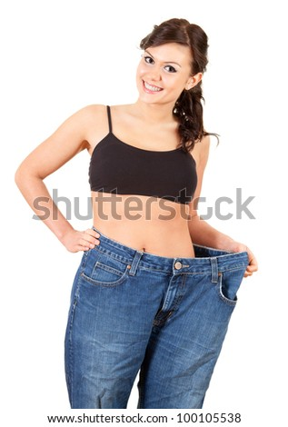 girl showing how much weight she lost, white background