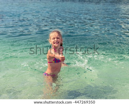 girl showing OK sign - stock photo