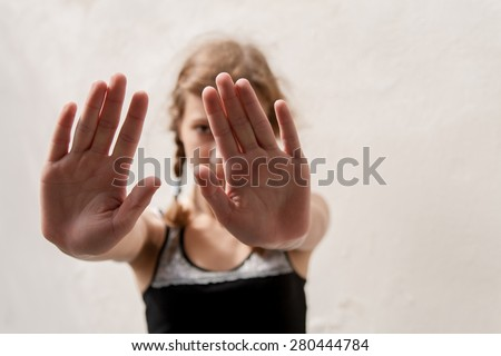 girl showing palms as rejectionist gesture - stock photo