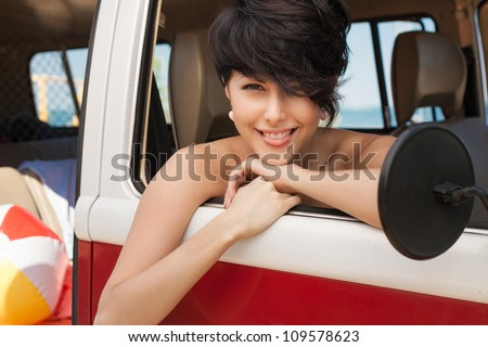 girl showing the language in car near the beach - outdoors