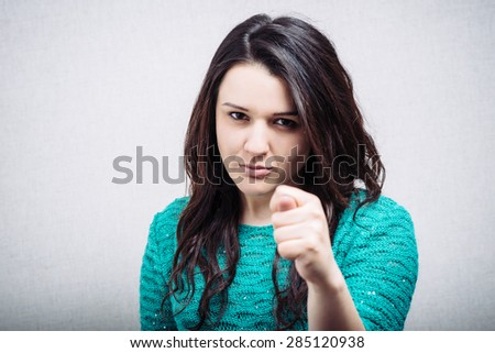Girl shows fist - stock photo