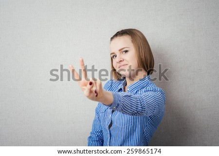 Girl shows two fingers - stock photo