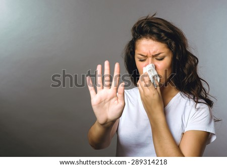 Girl sick cold with temperatures on a gray background   - stock photo