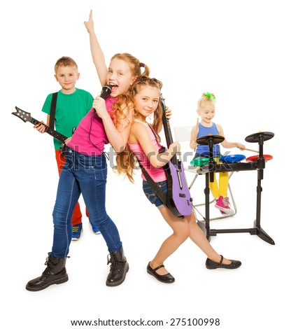 Girl singing and children playing as rock group - stock photo