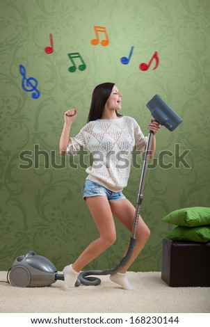 Girl sings while she tidies up the room, with colorful notes - stock photo