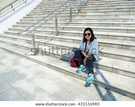 Girl sit on the stair stadium