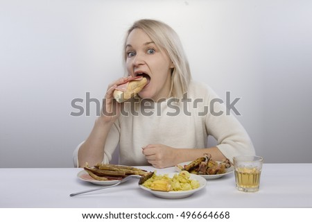 girl sits at table and eats. Junk food, poor diet, bulimia, anorexia, diet and slimming