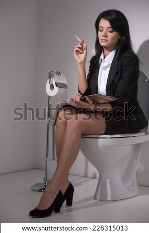 Girl Sits In Toilet And Smoking Cigarette Businesswoman Reading Magazine On Seat