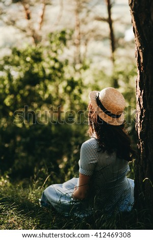girl sits under the tree - stock photo