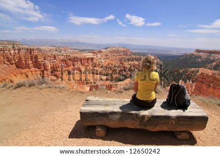 Girl sitting and looking at landscape in Bryce Canyon national park, Utah, USA - stock photo