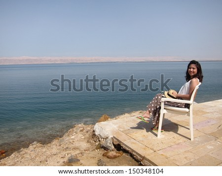 Girl sitting at Dead Sea, Jordan