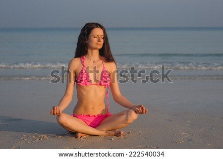 girl sitting in the lotus position - stock photo