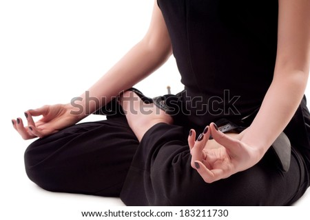 girl sitting in the lotus position. Isolated background