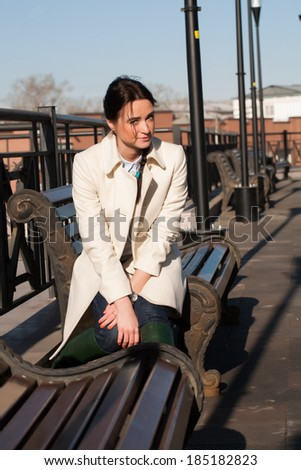 Girl sitting on a bench in the city