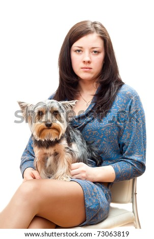 girl sitting on a chair with a small dog