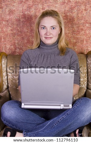 Girl sitting on a chair working on her Laptop