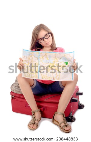 girl sitting on a suitcase looking at a map on white background