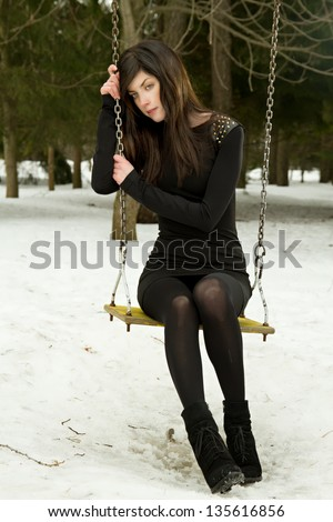 Girl sitting on a swing, hot teen toes