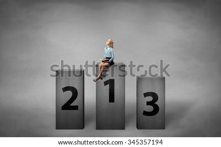 girl sitting on pedestal and reading a book - stock photo
