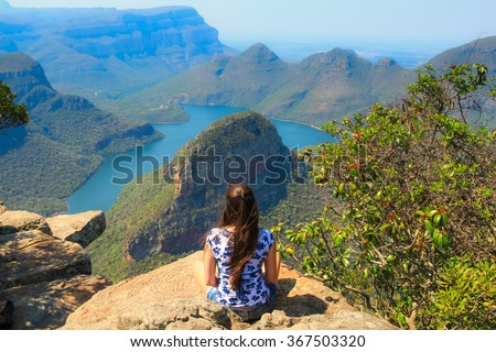 Girl sitting on stone on the cliff in the Blyde River Canyon, South Africa - stock photo