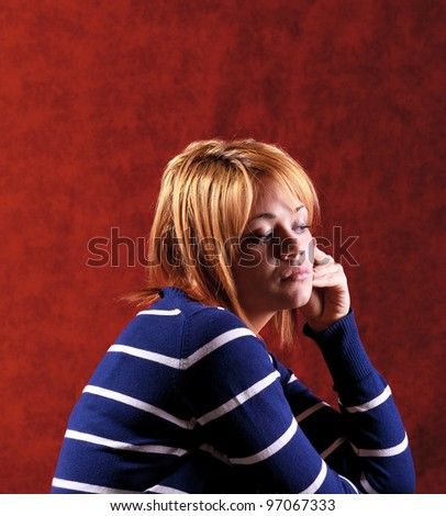Girl sitting on the stool on red background