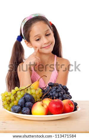 Girl sitting on the table with plate of fruit, isolated on white - stock photo