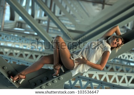 girl sitting sexy under the bridge