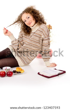 girl sitting with a book in the Bible, and food