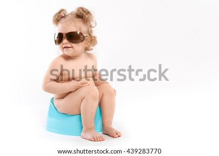 Girl sitting with glasses on a pot on a white background - stock photo